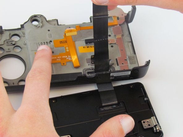 Use your fingers to separate the LCD screen from the folding mechanism.