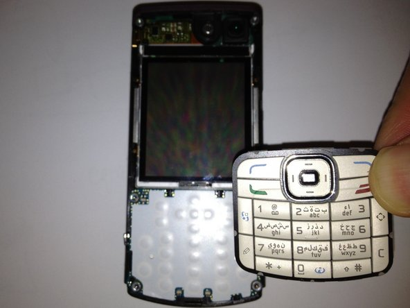 Image 2/3: Remove the keypad by lifting it away from the phone.