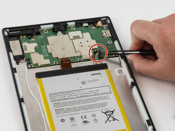 Image 1/3: Carefully unplug the battery power cable to disconnect the battery from the motherboard.