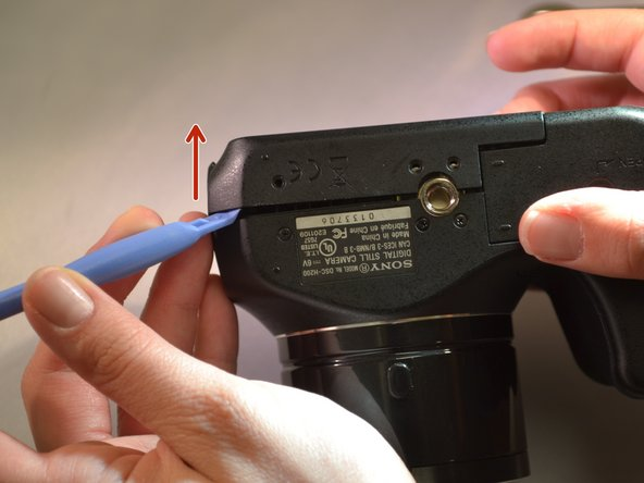 Using the blue plastic opening tools, remove the back panel (the LCD and motherboard are exposed).