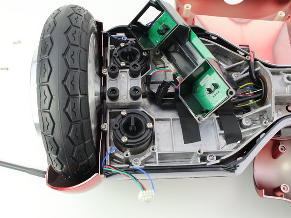 Remove the three 10 mm Phillips #1 screws connecting the balance sensor to the hoverboard.