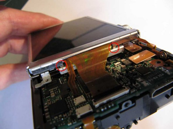 (Note that on reassembly, the LCD clamp has two small tabs which have to be located in the LCD frame.)