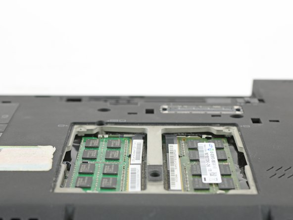 Push the marked claws to the side, to make the RAM accessible.