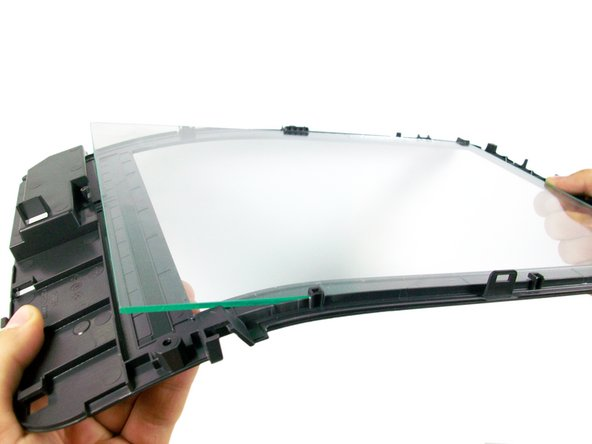 Remove the glass pane by carefully bending the plastic frame down from the side and sliding the glass pane out from the side.