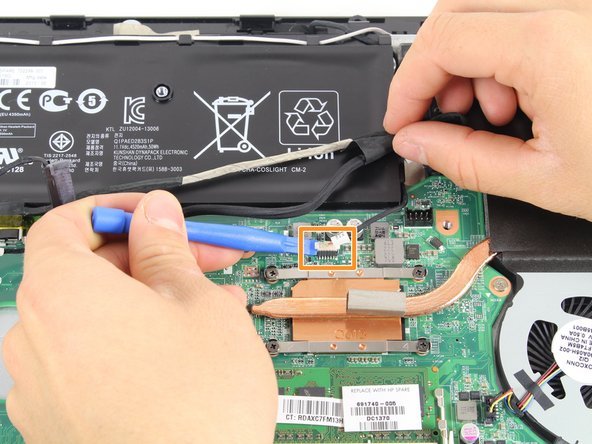 Disconnect the cable connection that's wrapped around the battery.
