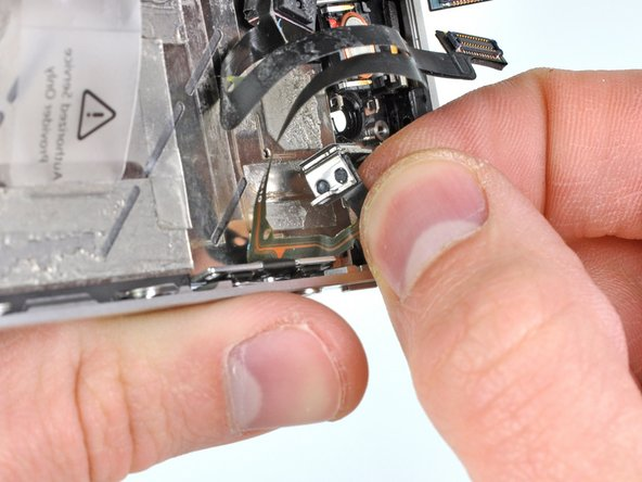 Gently pull the silent switch bracket away from the outer case and peel its small ribbon cable off the inside of the iPhone.
