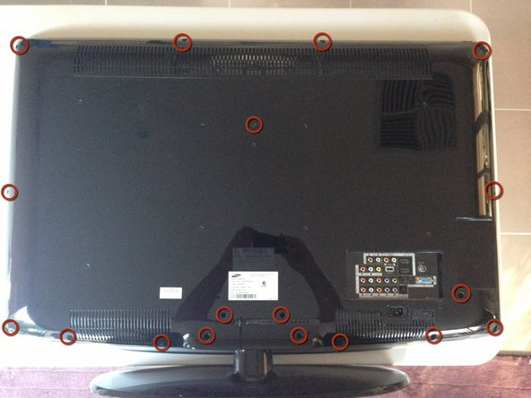 Image 1/1: Using a Philips driver remove the 18 screws from the rear panel.