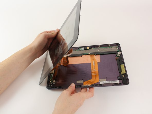 When the screen is free of all spring clips and adhesive, slowly open the device like a clam shell with the hinge being the left hand side of the device.