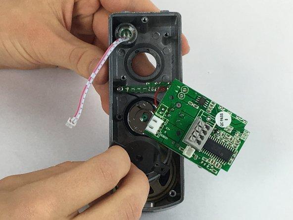 Remove the metal circular doorbell button.