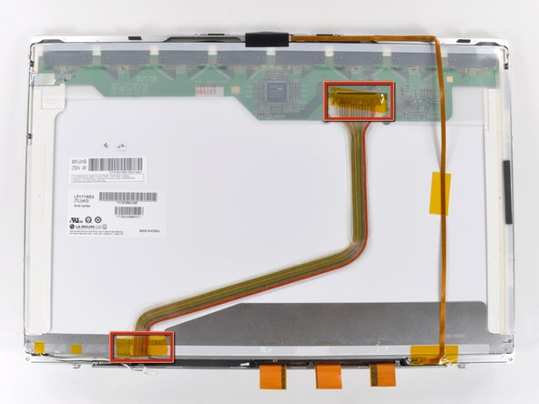 Remove the two pieces of tape securing the display data cable to the LCD.