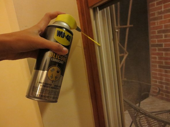 Apply a thin coating of the silicone spray onto the windows' channels.