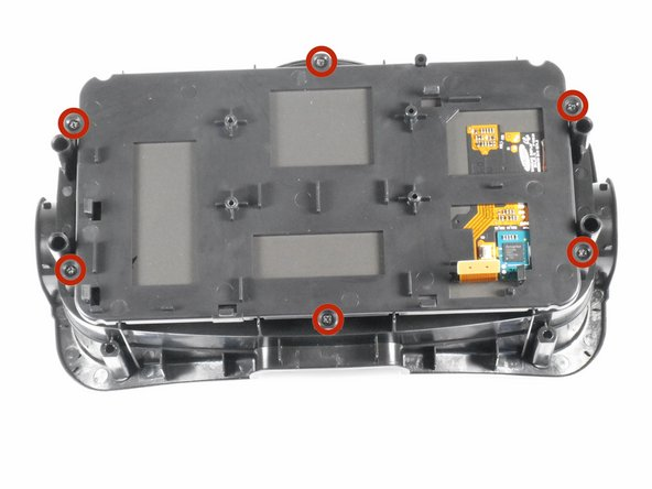 Image 1/3: Gently lift the plastic screen holder and display screen away from the remaining piece of the faceplate.