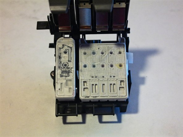 The ink cartridges can easily be removed after opening up the cover. +10 for repairability as this is the only part that will need to be replaced.