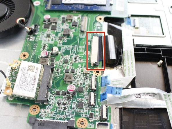 Use a spudger to flip up the retaining flap on the black ribbon cable ZIF socket.