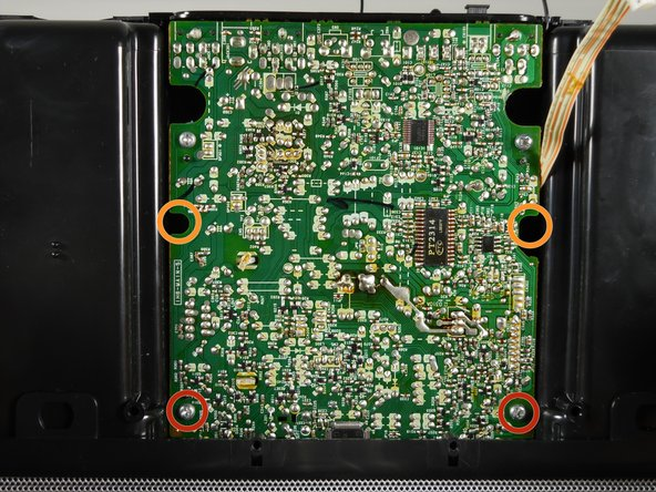 Remove the four screws attaching the top of the case to the motherboard:
