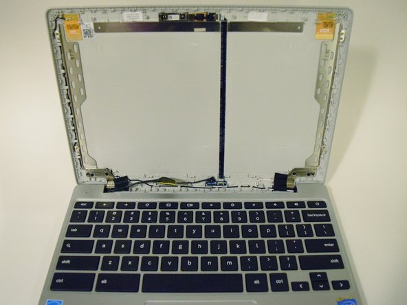 Pull the screen from the front panel using your hands to fully remove it.