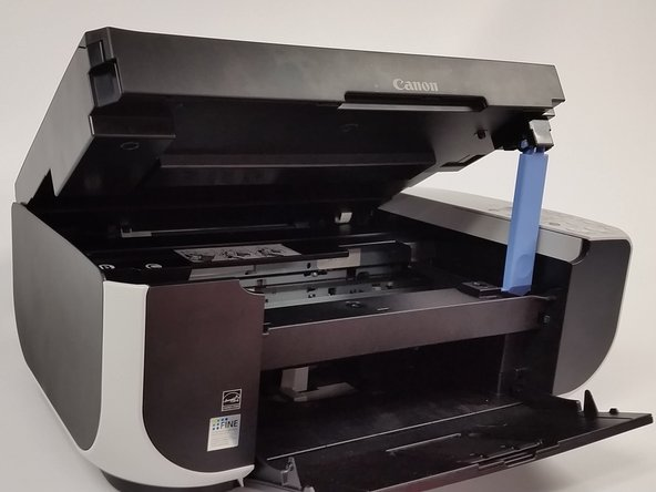 Lift the scan bed into the upright position.