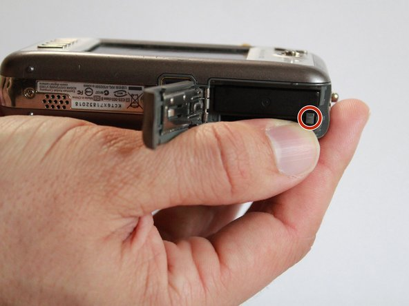 Image 1/2: Push memory card into memory card slot, until it clicks into place.