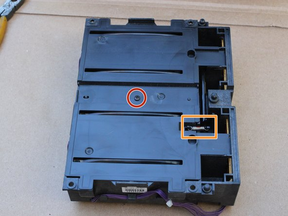 Place the optical sub-assembly with the side that was facing you down.