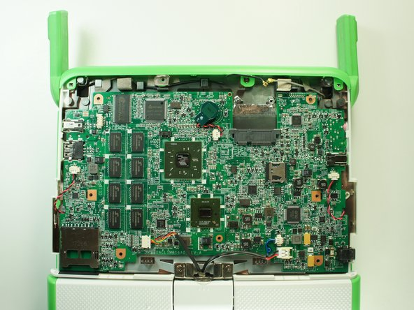 Image 1/3: Lift the left edge of the motherboard and remove it from the case.