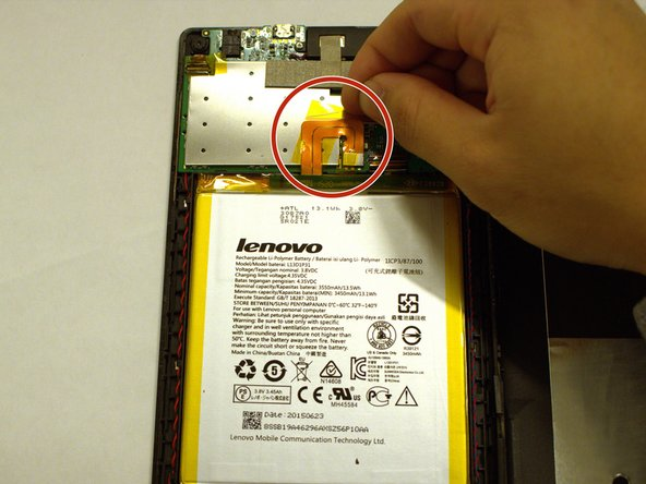 The battery is connected to the motherboard by the thin wire shown here.