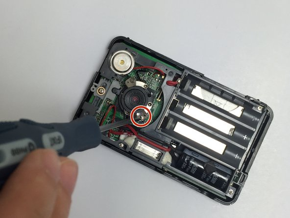 Remove the two 2.3 mm screws surrounding the lens using the Phillips #000 screwdriver.