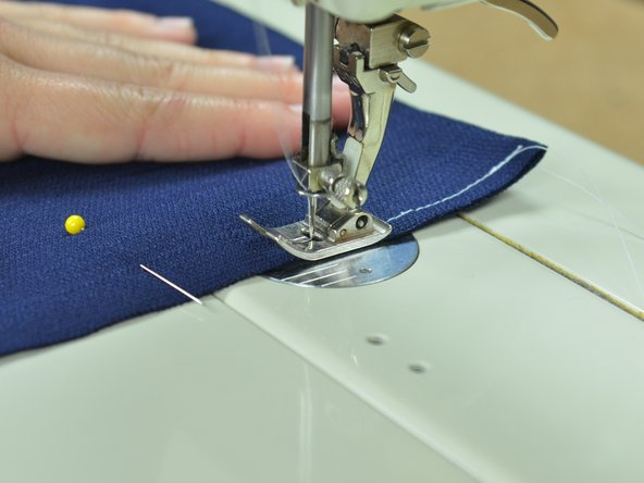 Keep the fabric aligned to the edge of the presser foot as you sew.