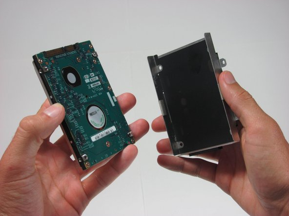 Separate the hard drive from hard drive bracket to complete removal.