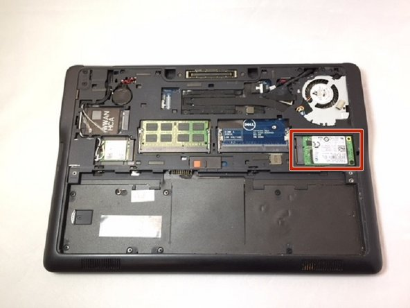 Locate your SSD, it is on the right side and held in with a small screw.