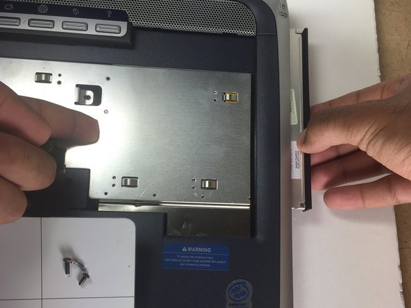 After the screws have been removed, use one finger to push the CD Rom out while the other hand is simultaneously pulling the CD Rom out.