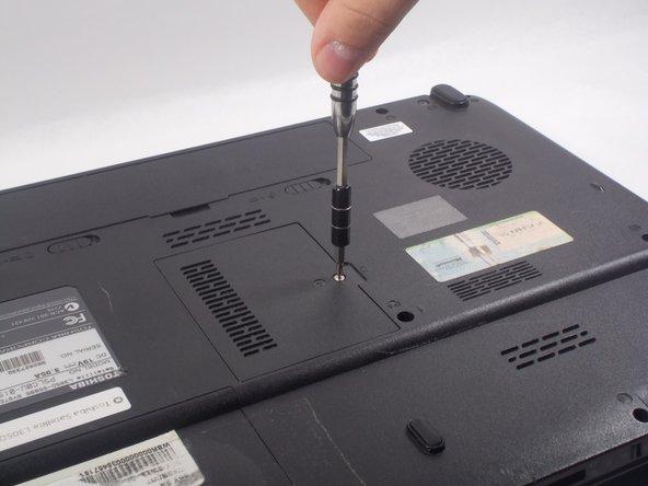 Undo the screw using the screwdriver.