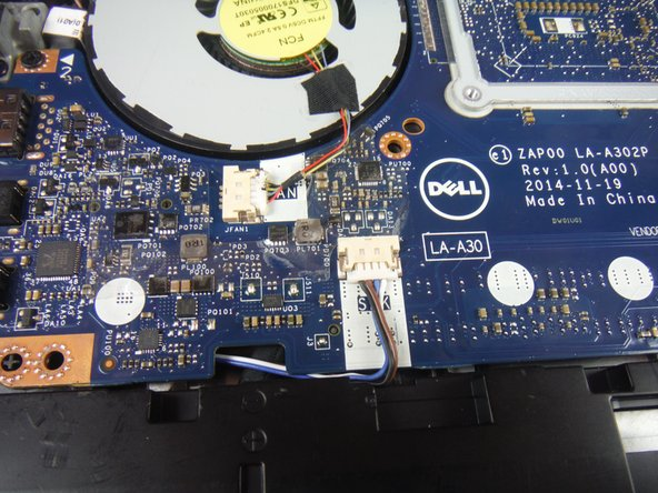 Disconnect the speaker cable connector from the service board.