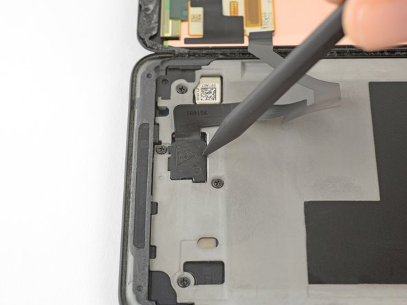 Insert the point of a spudger into the small hole on the edge of the OLED panel connector cover.