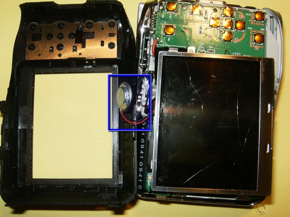 Do not remove the back side of the case, just flip it over. The speaker is connected by wires to the main body, but positioned in the back case.