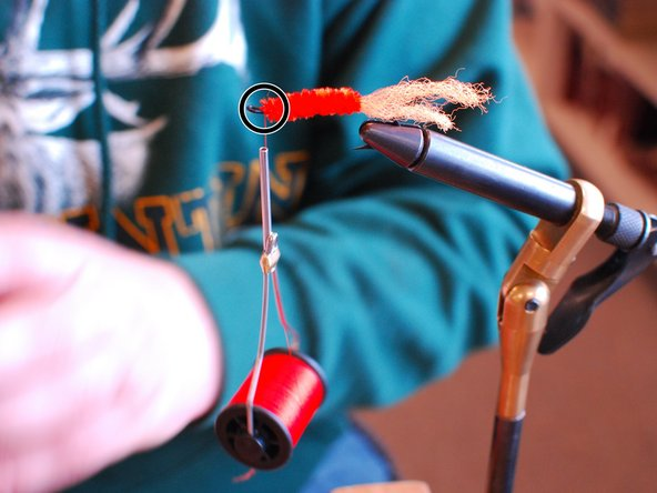 Image 3/3: Next you rap the body of the hook with the chenille and when you get to the eye you tie it off and cut off any extra.