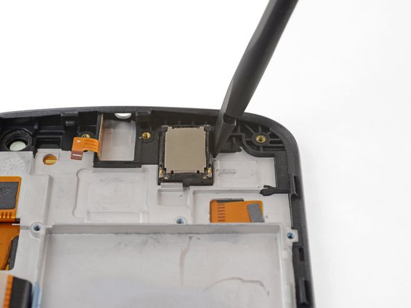 Using the flat of your spudger, pry up on the upper right edge of the earpiece speaker to separate it from the frame.