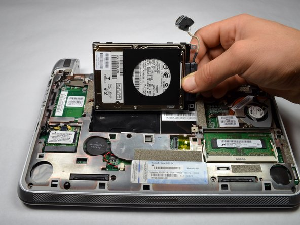 Image 2/2: Remove the hard drive.