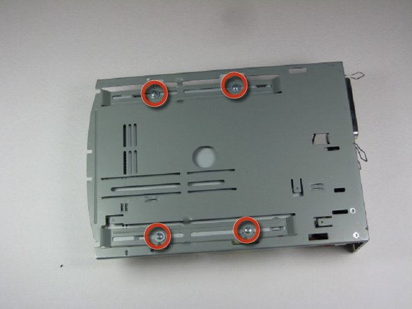 Image 1/2: Remove 4 screws with Phillips #1 screw driver.
