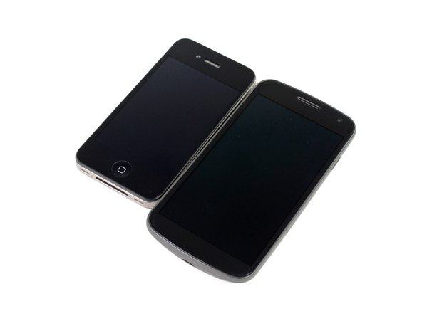 Image 1/2: In terms of size, the Galaxy Nexus is big enough (5.33 x 2.67 x 0.35 inches) to devour the 4S, so hopefully you have large pockets.