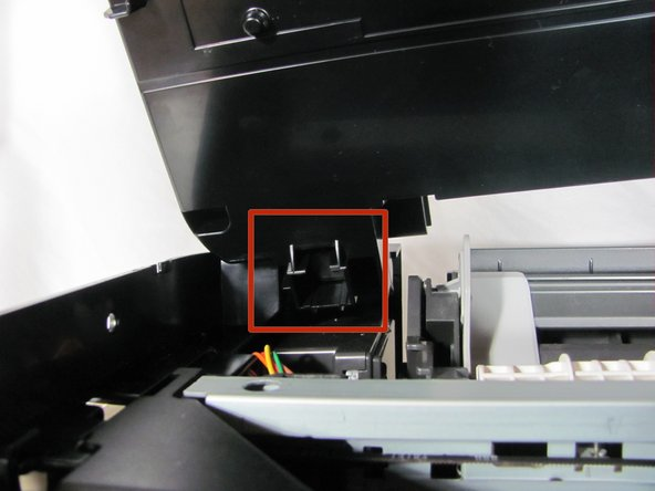 The scanner will still be attached with wires on the right side. Be careful not to yank the part away from the main body of the printer