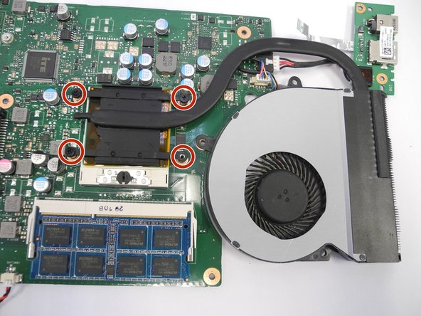 Unscrew the four screws with a Phillips Head #1 screwdriver to disconnect the fan from the processor.
