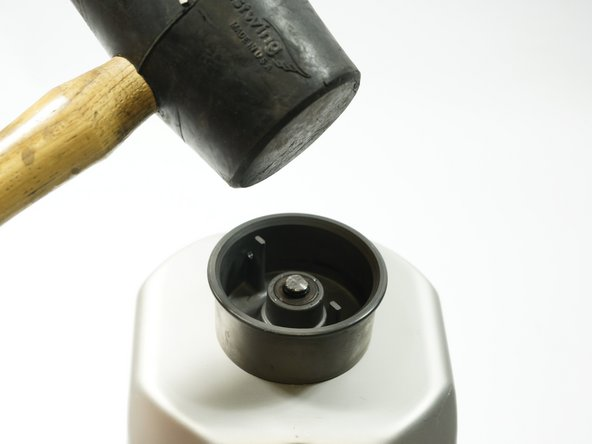 Use a rubber mallet or other blunt object to push the bolt until it is flush with the seal.