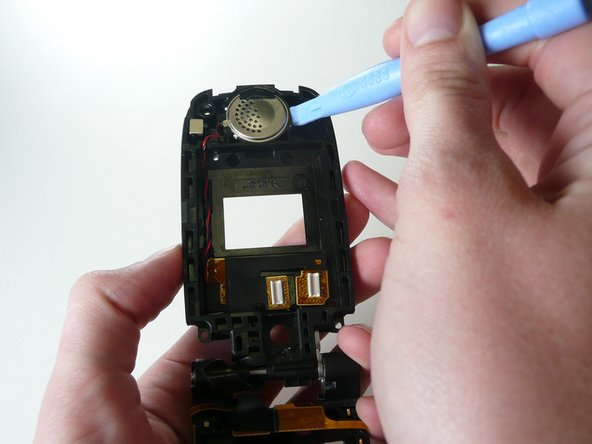 Use the iPod opening tool to place under speaker and pop it out.