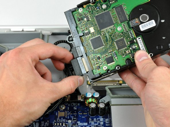 Twist the spudger counter-clockwise to slightly separate the SATA power cable connector from its socket on the hard drive.