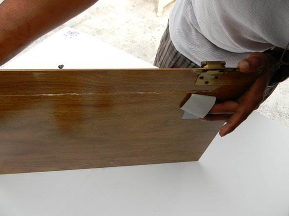 Attach and align the smaller cabinet door section to the bigger cabinet door section. Press them firmly together and apply the duct tape on both ends for bonding support.