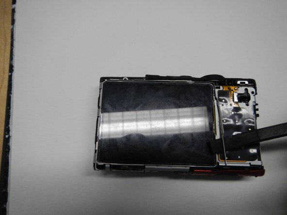 Remove the L shaped bracket around the top and right side of the LCD screen