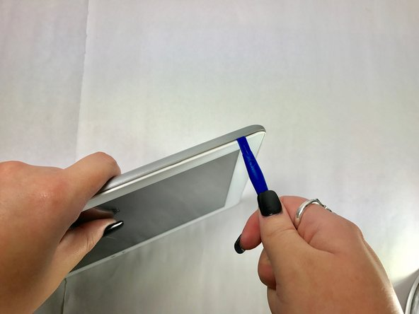 Repeat this process for the two shorter edges of the tablet leaving the top edge by the camera still snapped in place.
