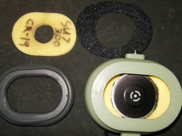 Filter removed, and another filter is visible around the speaker. The original headset will have three filters