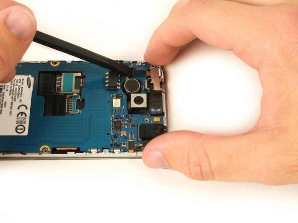 Use the flat end of a nylon spudger to lift the front-facing camera press-fit connector up to release the ribbon cable.