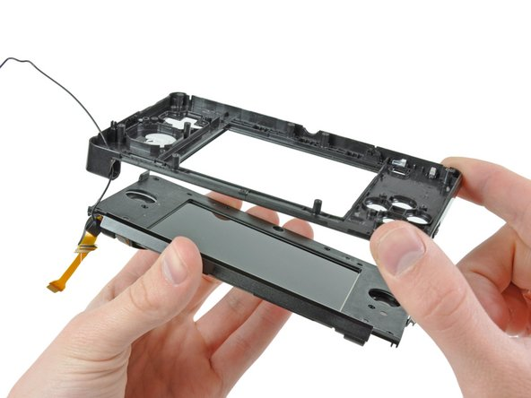 Image 3/3: Threading the upper display and camera cables through the tiny hinge tube is something that Nintendo undoubtedly accomplishes by the use of robotic machinery.